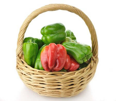 Green and Red Sweet Pepper In A Basket