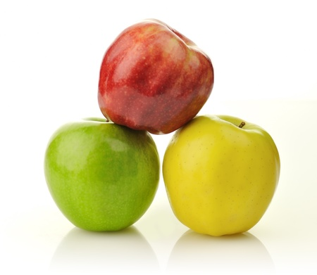 Yellow, green and red apples on white background photo