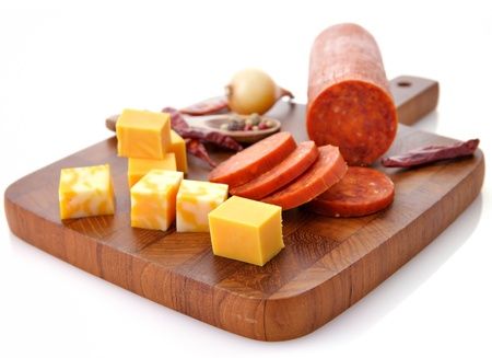 Pepperoni Salami and cheese on a cutting board Stok Fotoğraf
