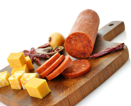 processed: Pepperoni Salami and cheese on a cutting board Stock Photo