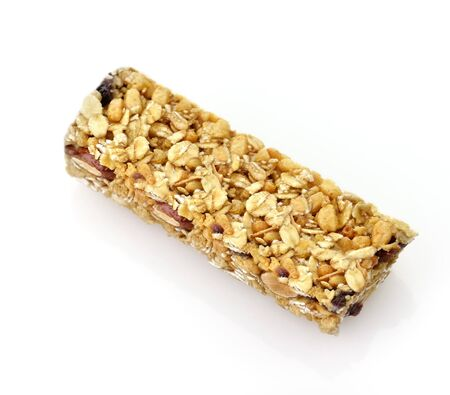 cereal bar: Healthy cranberry snack bar on white background Stock Photo