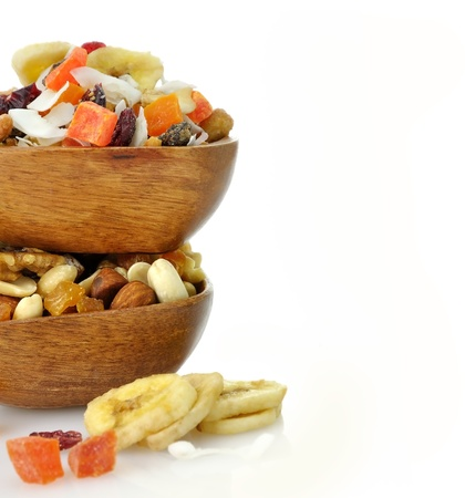 mix fruit: Delicious and healthy mixed dried fruit, nuts and seeds in the wooden bowls
