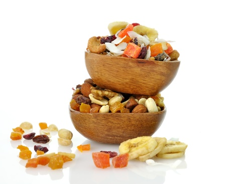 Delicious and healthy mixed dried fruit, nuts and seeds in the wooden bowls