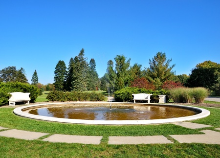 a fountain and benches in a public park
