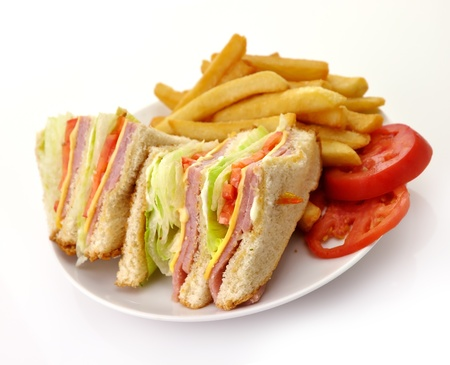 chicken sandwich: Turkey Or Ham Club Sandwich And French Fries  Stock Photo