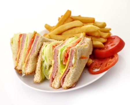 Turkije of Ham Club Sandwich en Frans Fries Stockfoto
