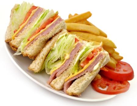 Turkey Or Ham Club Sandwich And French Fries