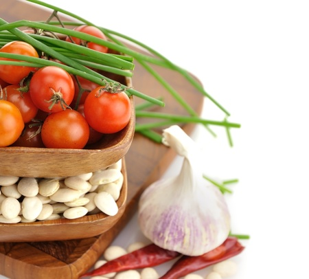 Baby Lima Beans , Tomatoes And Spices In Wooden Bowls photo