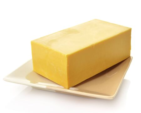 A block of Cheddar Cheese In A Dish