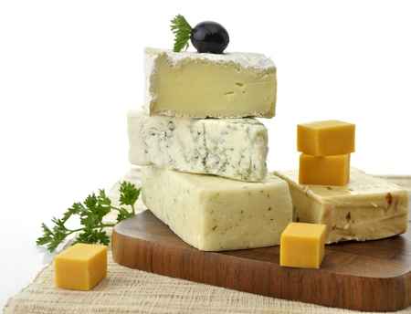 kinds: A Stack Of Different Kinds Of Cheese On White Background Stock Photo