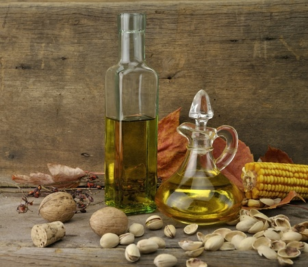 jag: Cooking Oil And Autumn Items On Wooden Background Stock Photo