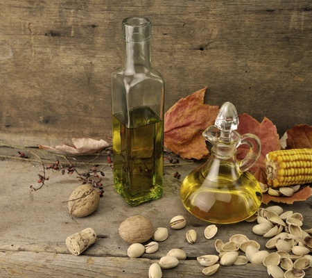 nut shell: Cooking Oil And Autumn Items On Wooden Background Stock Photo