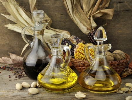 Cooking Oil  , Vinegar And Autumn Items On Wooden Background Stock Photo