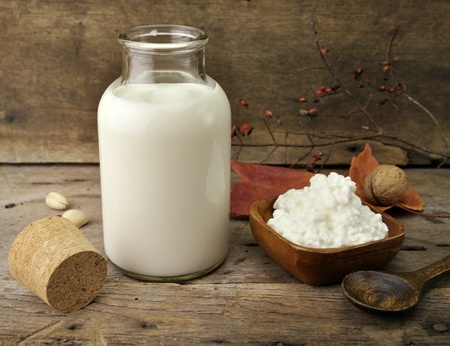 Fresh Milk And Cottage Cheese On Wooden Background Фото со стока