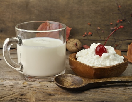 diet product: Fresh Milk And Cottage Cheese On Wooden Background Stock Photo
