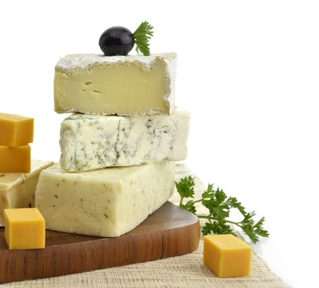 various: A Stack Of Different Kinds Of Cheese On White Background Stock Photo