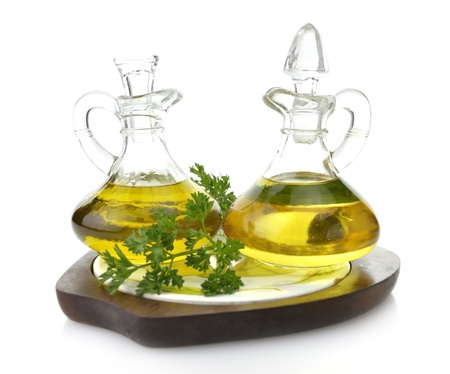 cooking oil: Cooking Oil Glass Bottles On Wooden Board