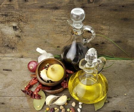 vinegar bottle: Cooking Oil Vinegar And Spices On Wooden Background