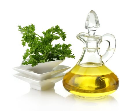 cooking oil: Cooking Oil And Parsley On White Background Stock Photo