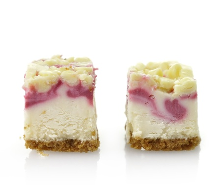 Raspberry Cheesecake Slices On White Background, Close Up Reklamní fotografie