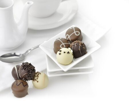 Chocolate Candies Assortment In A White Dish photo