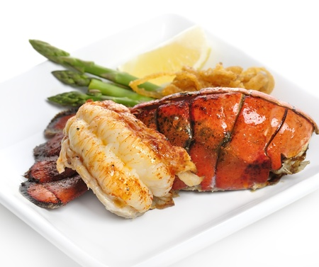 lobster tail: Grilled Lobster Tail Served With Asparagus And Onion