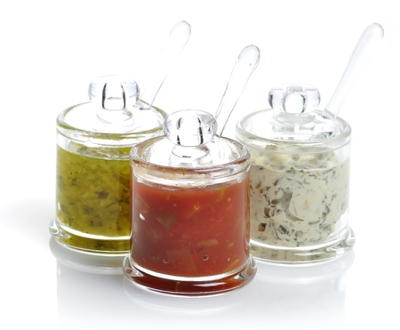 hot sauce: Various Dips In Glass Jars On White Background