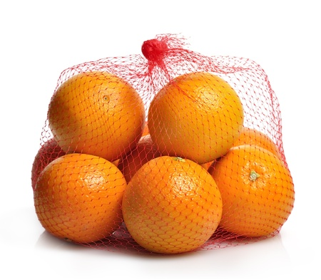 Oranges In A Bag On White Background
