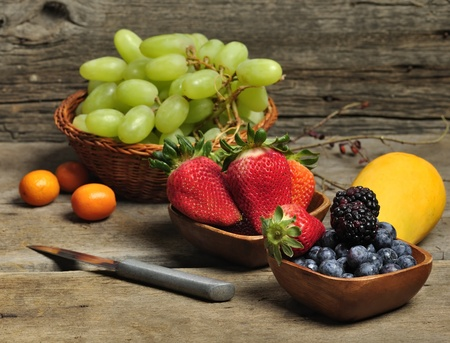 Fresh Fruits And Berries On Wooden Background Stock fotó