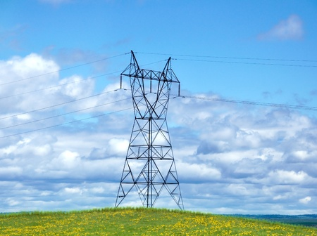 power line tower: Power Tower On A Hill Against A Blue Sky Stock Photo