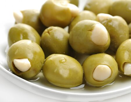 olive green: Green Olives Stuffed With Almonds Stock Photo