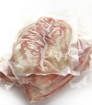 cod: Frozen Fish Fillets In A Vacuum Package  Stock Photo