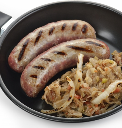 Sausages With Sauerkraut In A Frying Pan Stock Photo