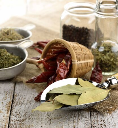 Spices And Herbs On A Wooden Table