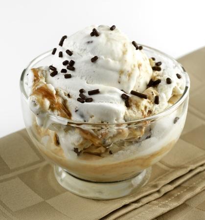 Glass Bowl Of Ice Cream With Caramel Sauce ,Close Up Stock Photo