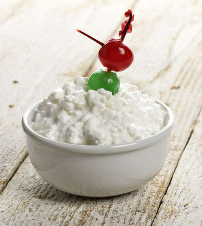 Cottage Cheese With Cherries In A White Bowl