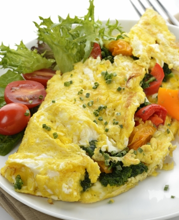 an omelette: Omelet With Lettuce And Vegetables