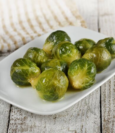 Roasted Brussels Sprouts  In A White Dish 写真素材