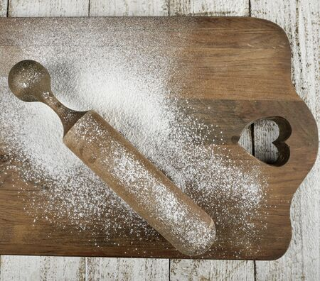 pin board: Wooden Rolling Pin With Flour On A Wooden Board
