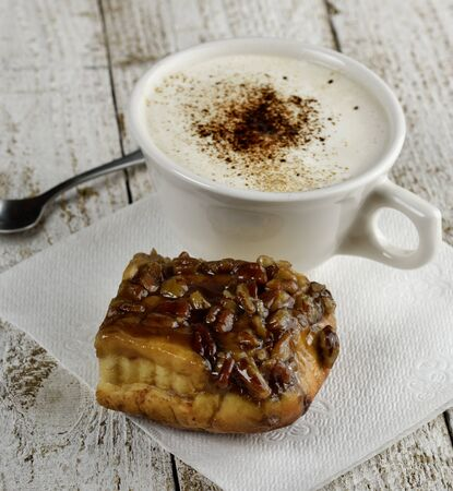 Pecan Coffee Cake And A Cup Of Coffee photo
