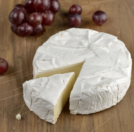 Brie Cheese On A Wooden Board