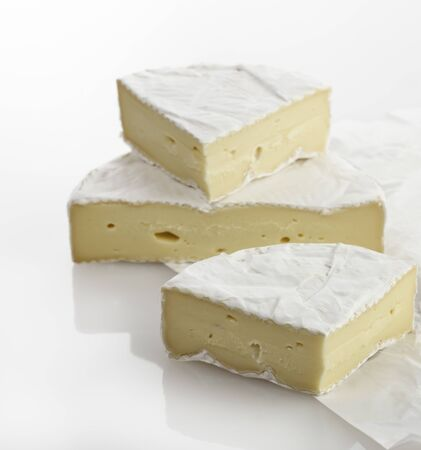 brie: Wedges Of French Brie Cheese On White Background