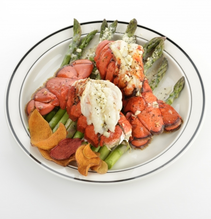 lobster tail: Grilled Lobster Tail Served With Asparagus Stock Photo