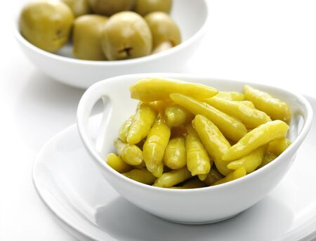 pickled: Pickled Hot Yellow Pepper And Stuffed Olives Stock Photo