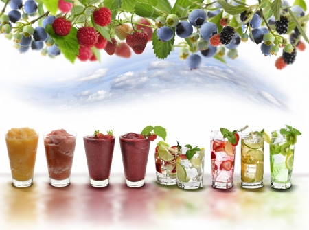 fruit drinks: Glasses Of Colorful Fruit Drinks Stock Photo