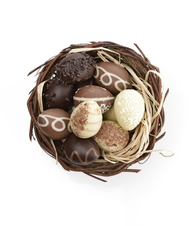 Chocolate Eggs Collection In A Nest On White Background