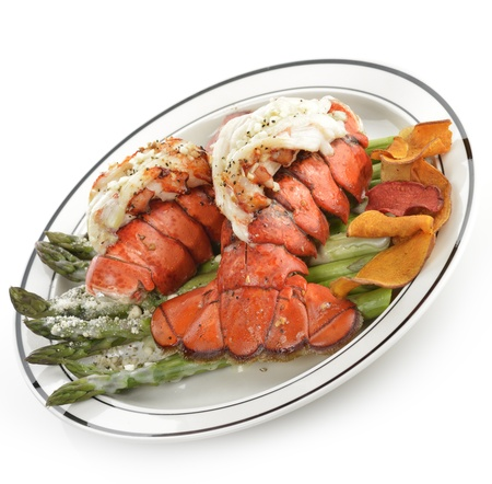 lobster tail: Grilled Lobster Tail Served With Asparagus On White Background Stock Photo