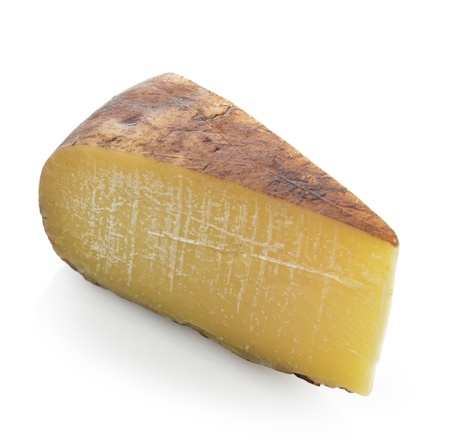 Wedge of Hard Cheese On White Background