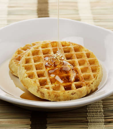 Waffles With  Maple Syrup And Honey In A White Plate photo