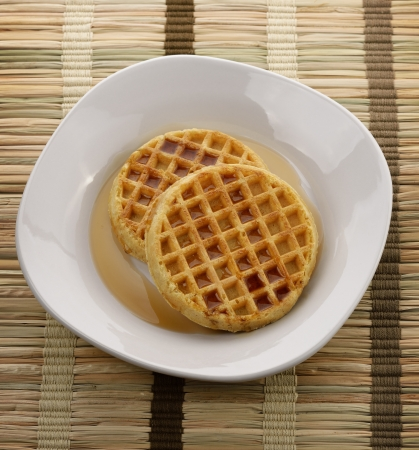 Waffles With  Maple Syrup In A White Plate photo